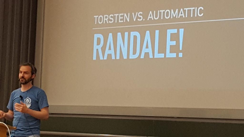Torsten in front of slide saying Torsten vs. Automttic – Randale!